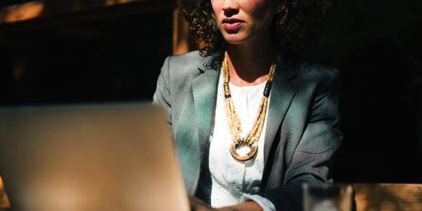 What is stalling progress for women at work?